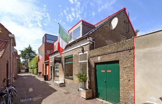 Verstrekte hypothecaire lening op een commerciële ruimte (te verbouwen naar twee studio's) met bovenwoning bestemd voor de verhuur te Delft